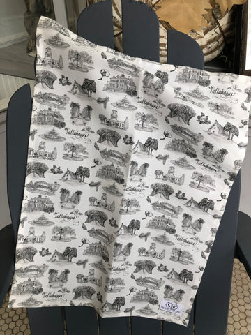 There is a tea towel made of black and white Toile of Tallahassee fabric.