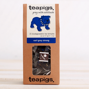 "Pictured is the packaging for Teapigs Earl Grey Strong tea. The box is brown with a clear plastic window that shows the teabags inside. The label is white with a blue bulldog and has the words ""teapigs grey with attitude 15 biodegradable tea temples earl grey strong."""