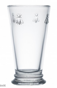 A clear glass highball with four bees embossed on opposite sides.