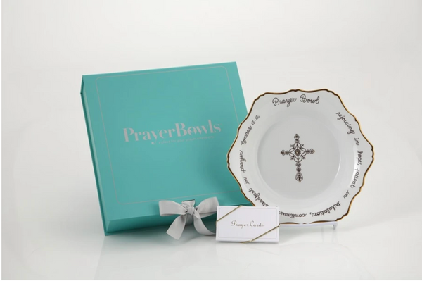 Pictured is the Celeste Prayer Bowl displayed next to its box and prayer cards.