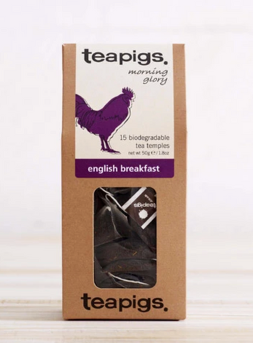 "Pictured is a rectangular package of Teapigs English Breakfast Tea. There is a clear plastic window on the packaging that the teabags can be seen through. There is a white label with a purple rooster and the words ""teapigs morning glory 15 biogradable tea temples english breakfast."""