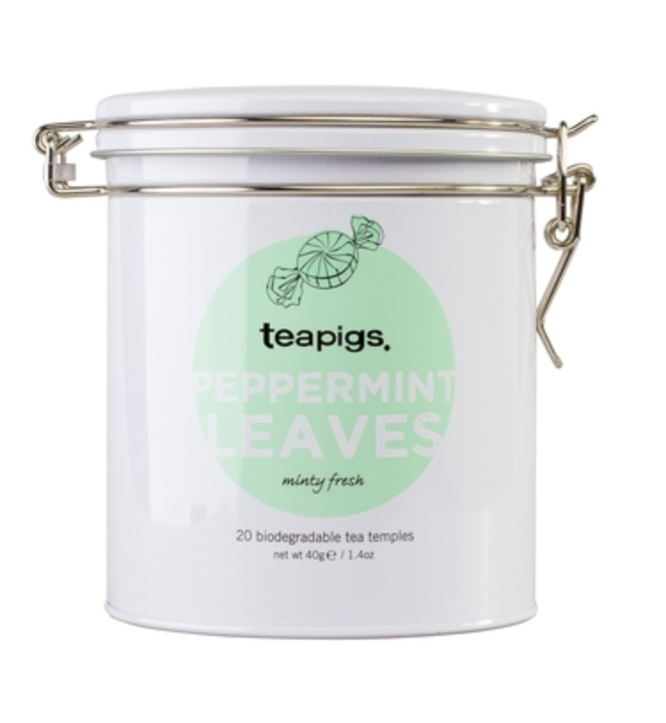 "Pictured is the packaging for teapigs peppermint tea. It is a white tin with a latch to keep it closed. There is a light green circle with an illustration of a peppermint. The label reads ""teapigs peppermint leaves minty fresh 20 biodegradable tea temples."""
