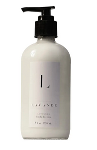 "Pictured is a glass lotion dispenser with a pump top lid. It is filled with lotion and it has a white label on it that reads ""L LAVANDE LAVENDER body lotion"""