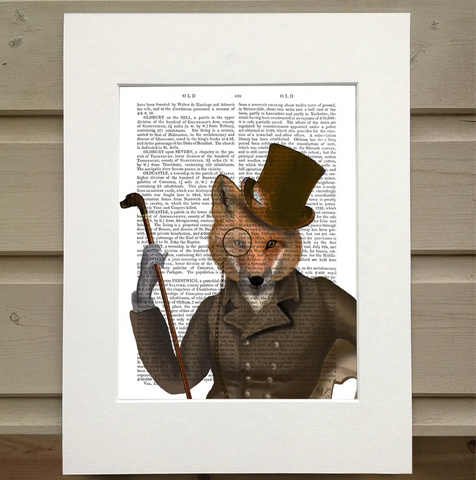 Pictured is a page from a book framed by mat. There is an image printed opaquely over the words on the page. The print is of a figure from the waist up. They appear to be sitting down and they are wearing an old fashioned hunting jacket, a scarf, a monocle, and a tophat. They hold a cane decorated with the head of a hound dog carved at the end. The figure has the head of a fox.