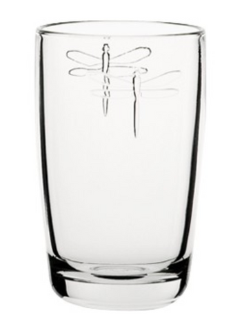 A tall juice glass with two dragonflies embossed on it.