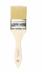 Pictured is a simple, natural wood paint brush with a wide, flat tip.