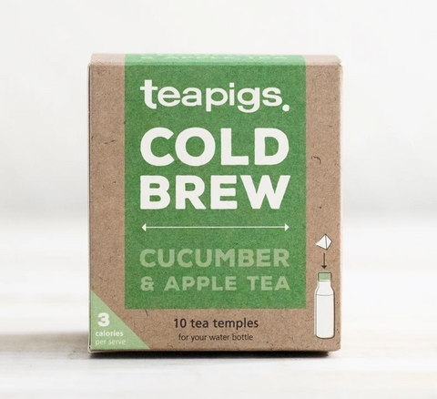 "Pictured is the packaging for Teapigs Cold Brew Cucumber and Apple tea. It is a brown box with a green label that reads ""teapigs COLD BREW CUCUMBER & APPLE TEA,"" ""10 tea temples for your water bottle."" There is a drawing of a water bottle with an arrow pointing a teabag toward the bottle's lid."