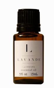 "Pictured is a small dark glass bottle with a twist top. It has a white label that reads ""L LAVANDE LAVENDER essential oil"""
