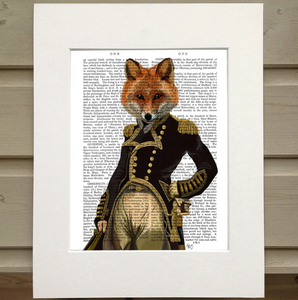 Pictured is a page from a book framed in mat. Printed over the words on the page is an illustration of a figure wearing a black, old fashioned military jacket with gold detals and buttons. The figure has one hand on its hip and the other hanging at its side. The figure has the head of a fox instead of a human head.