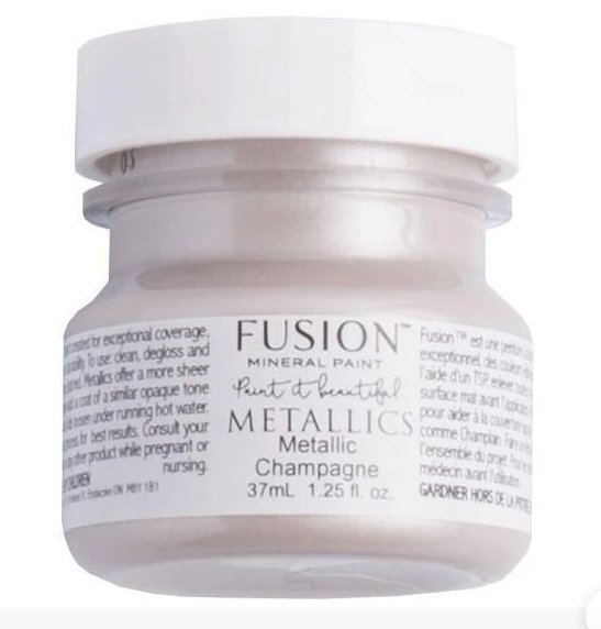 A 37ml container of Champagne Metallic Fusion Mineral Paint.