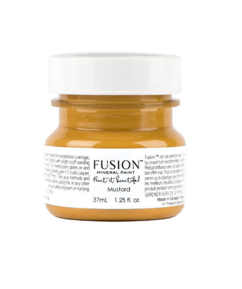 A tester (37 ml) sized container of Mustard Fusion Mineral Paint.