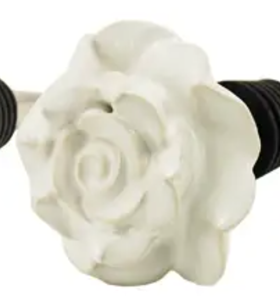 There is one white rose bottle stopper.