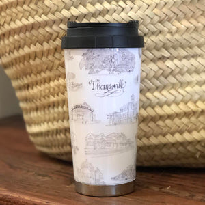 Pictured is a Toile of Thomasville black and white stainless steel travel mug. The base is plain stainless steel and the lid is black plastic.