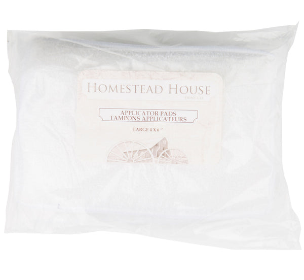 Pictured are two Homestead House Applicator Pads inside of their packaging.
