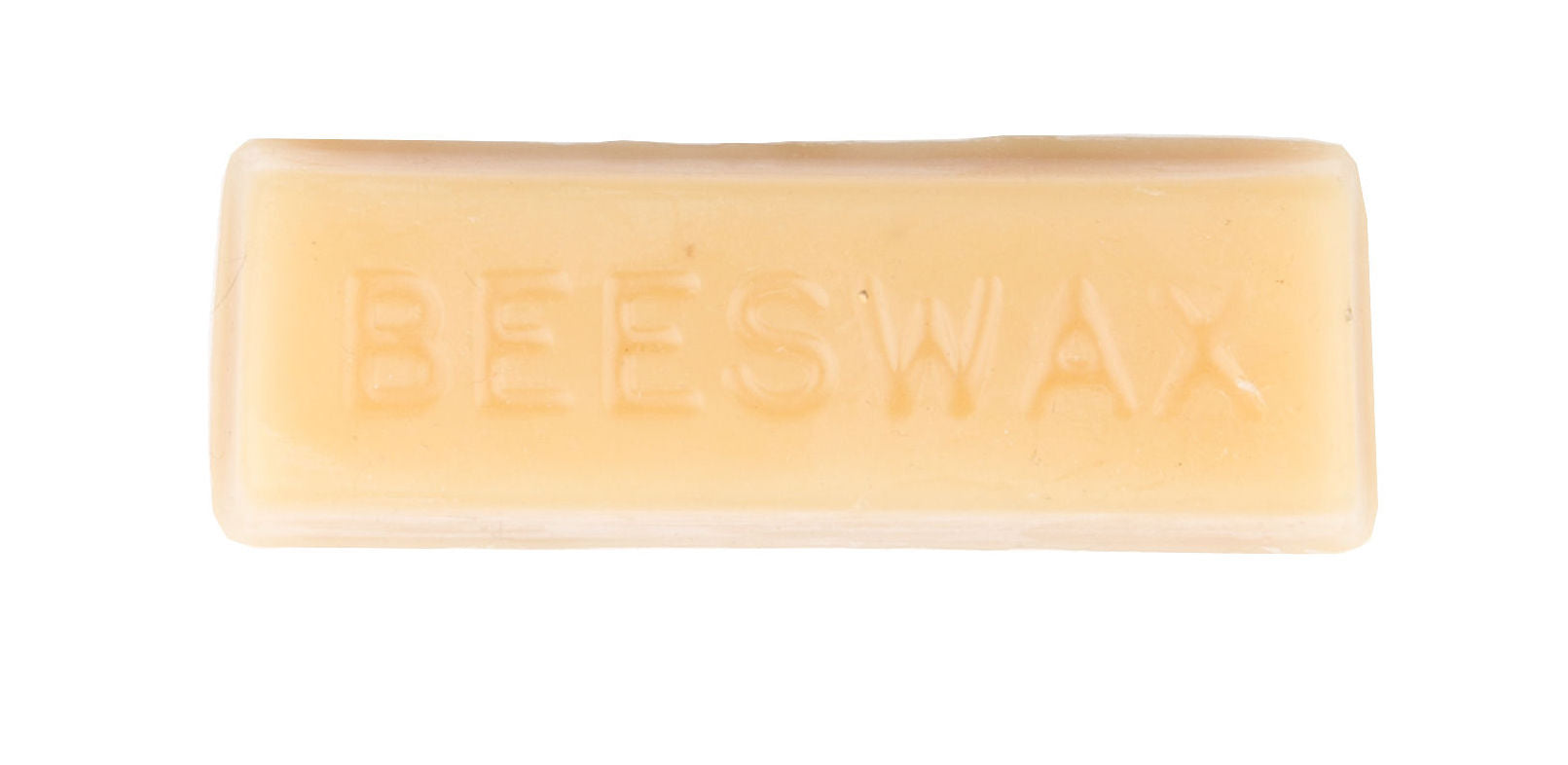 "Pictured is a rectangular block of hard wax. Printed into it is the word ""BEESWAX."""