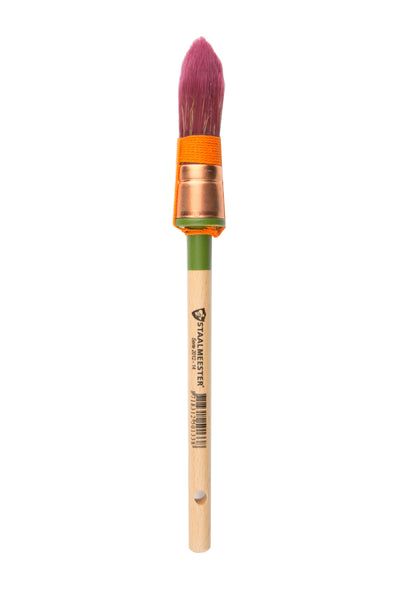 There is a staalmeester paintbrush with a pointed bristles. The bristles are red and the string wrapped around their base is orange. The handle is long and natural wood except for right below the bristles where there is a green stripe.