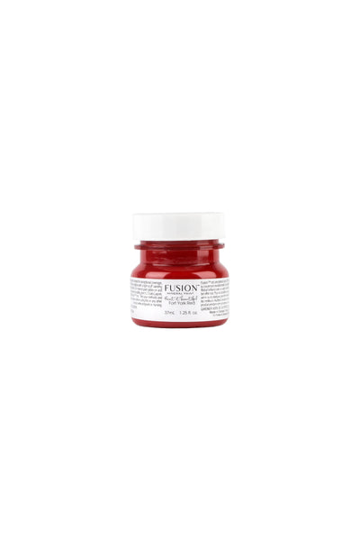 A tester (37 ml) sized container of Fort York Red Fusion Mineral Paint.
