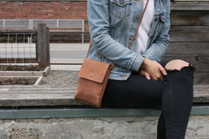 Eco-leather small unisex cross body bag designed in Toronto handcrafted in India female