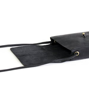 Eco-leather small unisex cross body bag designed in Toronto handcrafted in India interior