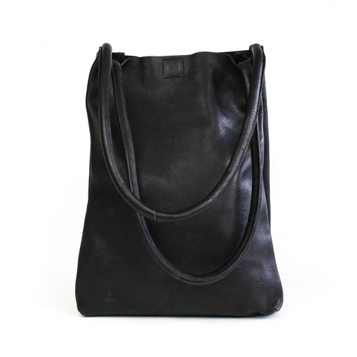 Eco-leather a-line minimal tote with interior divider and slip-in pockets. Designed in Toronto handcrafted in India. front