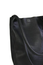Load image into Gallery viewer, Eco-leather a-line minimal tote with interior divider and slip-in pockets. Designed in Toronto handcrafted in India. Close-up