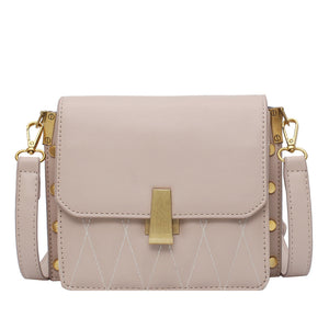 diamond pattern side edge rivet hasp cross body bag