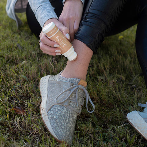 womans foot cbd topical roll on running