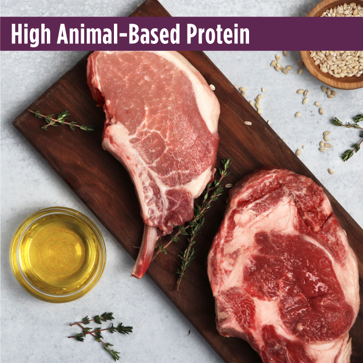 Raw pork and beef with fresh cut oats on a cutting board. Frontrunner pork, barley and beef recipe is a high animal- based protein kibble for your dog.