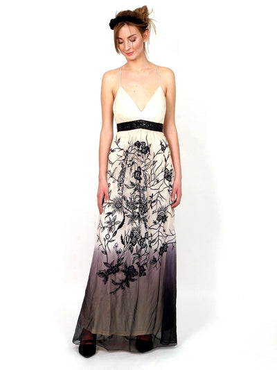 Long formal dress with slim shoulder straps.