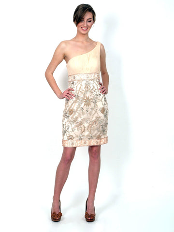 A festive one-shoulder gold mini dress.
