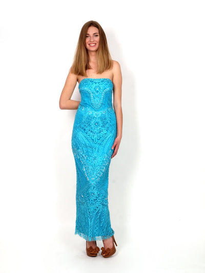 Long festive dress of turquoise color.