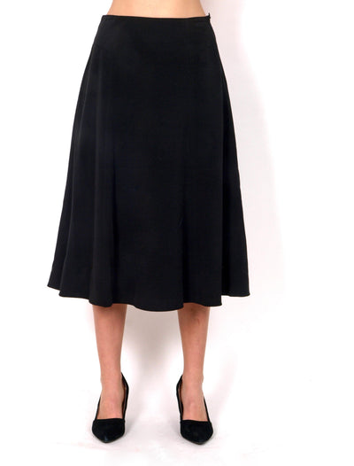 Black wider skirt bellow knees.