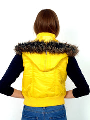 Warm yellow vest with faux fur