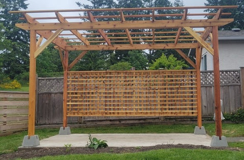 stained cedar pergola with privacy screen