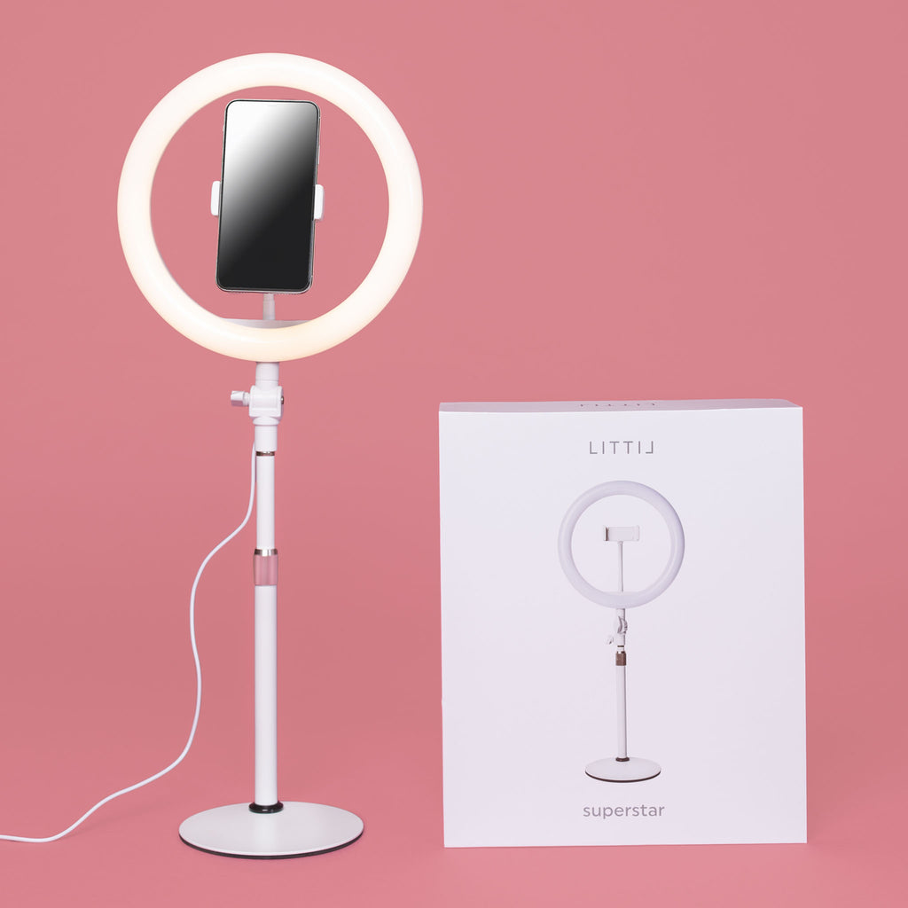 LITTIL Superstar Ring Light with product box on a pink background.