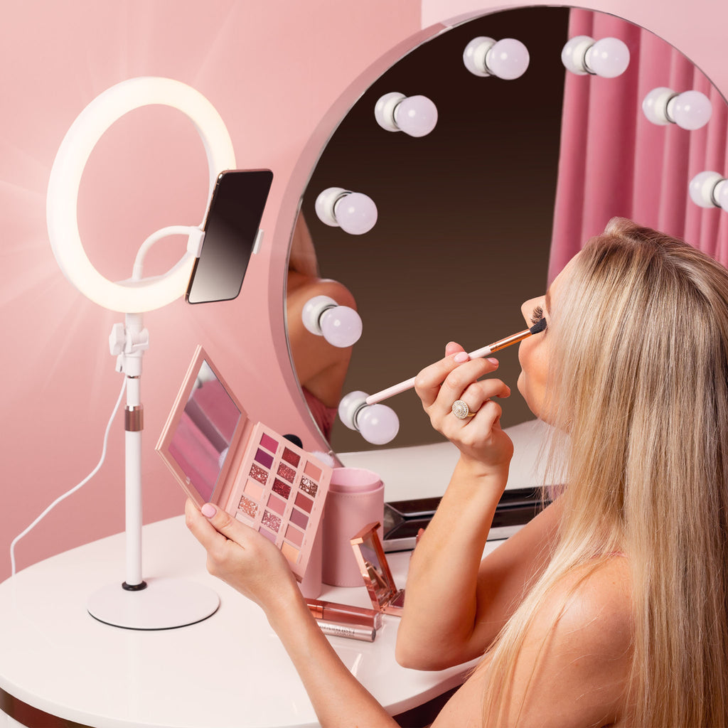 LITTIL Superstar Ring Light. Woman applying makeup in front of the ring light.