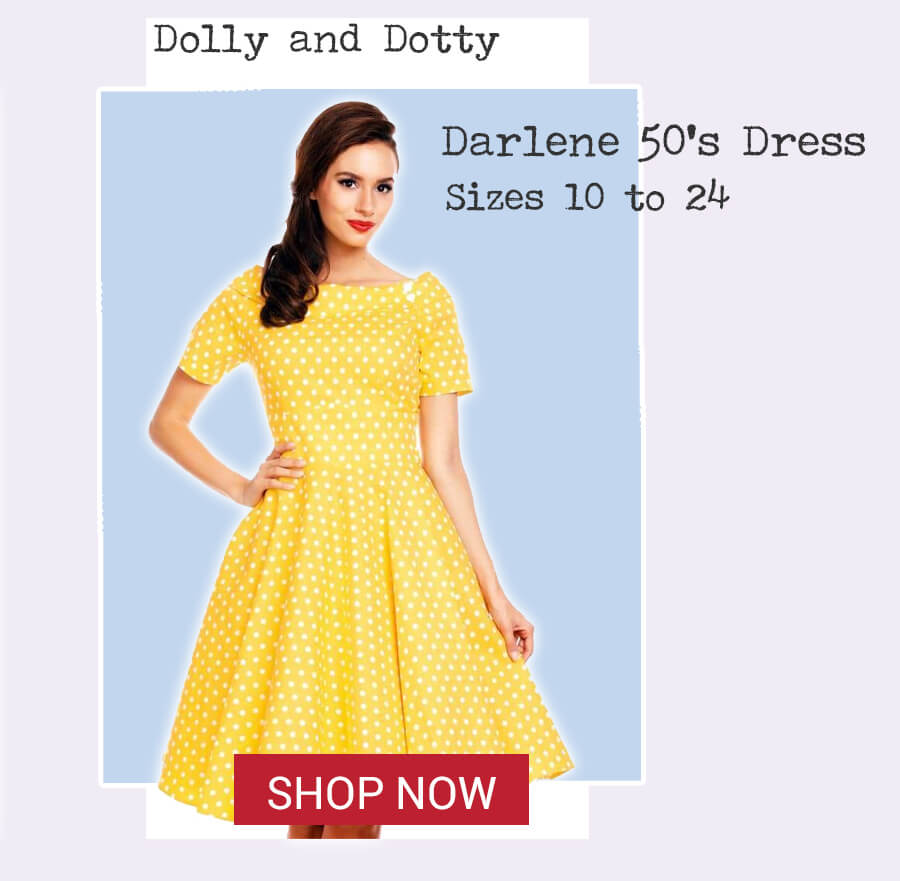 Image of model wearing Dolly and Dotty Darlene dress - yellow polka dot