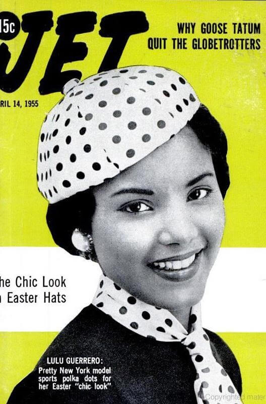 Retro image of Lulu Guerrero  in matching polka dot hat and scarf