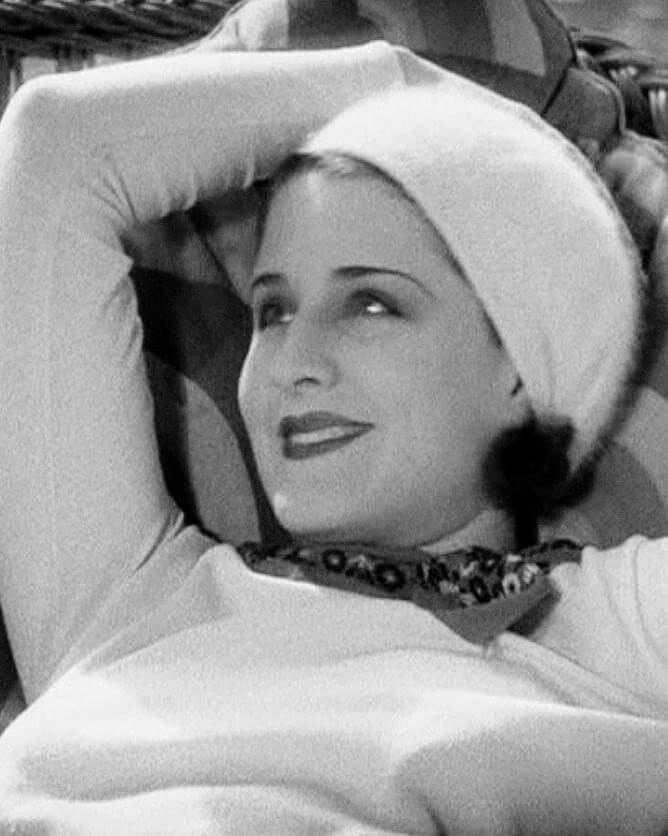 Image of Norma Shearer with head scarf