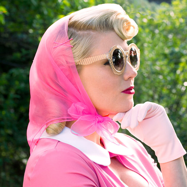 Image of model wearing Vintage Hairstyling Tidy Tresses Hair Scarf - Hot Pink - with gloves and sunnies