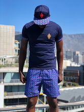 Blue t shirt with shweshwe and swim shorts and shweshwe peak cap