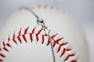 This one is for the biggest fan, the one who doesn't ever miss a game and proudly sports her favorite players number win or lose. This one is for you, Mom!   Product Details  Features Mom engraving Sterling silver Sterling silver cable chain Lobster clasp Pendant: 22mm Necklace box included
