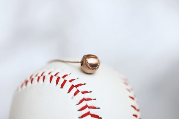 Wear this Baseball Pendant on game day and everyday!  Product Details  14k Rose gold,  18