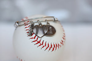 Create your own personalized charm bracelet!   This bracelet comes with the Baseball Heart Charm, please select any other charms that you would like to add to your bracelet!  If you would like to add a Jersey Number Charm: please select the number range you would like to order. There will be a place during Check Out to add this information in the