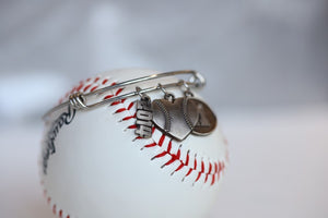 "Create your own personalized charm bracelet!   This bracelet comes with the Baseball Heart Charm, please select any other charms that you would like to add to your bracelet!  If you would like to add a Jersey Number Charm: please select the number range you would like to order. There will be a place during Check Out to add this information in the ""Note to Seller"" box.   Product Details  Bracelet is one size fits all Color: white Charms: white bronze"
