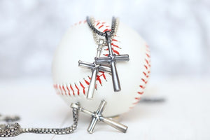 "Our largest baseball cross pendant! Perfect for making a statement! Product Details  Sterling silver cross pendant Sterling silver rounded box chain Lobster clasp Choose from 22"" or 24"" Necklace box included"