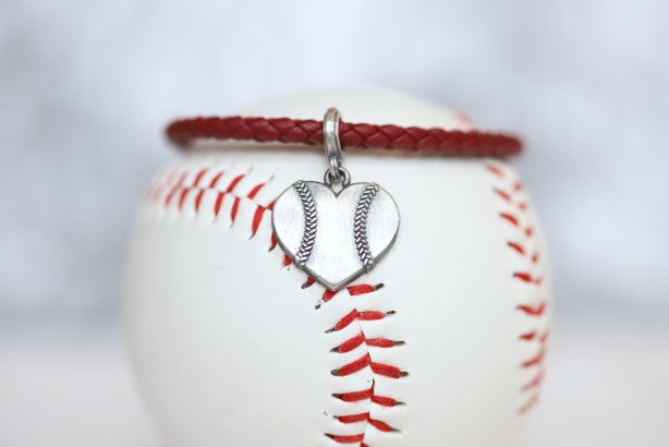 Customize your own Baseball Heart  leather bracelet!  Product Details  Sterling silver lobster clasp Fine Italian leather Choose from sterling silver baseball or baseball heart charm Choose bracelet length (Average size for women is 7