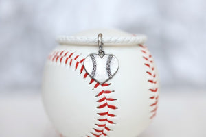 "Customize your own Baseball Heart  leather bracelet!  Product Details  Sterling silver lobster clasp Fine Italian leather Choose from sterling silver baseball or baseball heart charm Choose bracelet length (Average size for women is 7"")"
