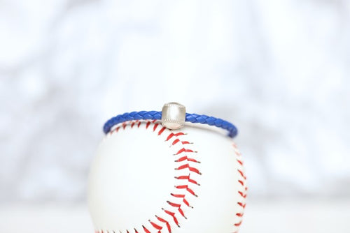 Customize your own baseball leather bracelet!   Product Details  Sterling silver lobster clasp Fine Italian leather Choose from sterling silver baseball Choose bracelet length (Average size for women is 7