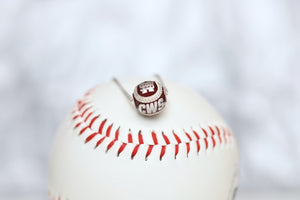 Show your support for Mississippi State Bulldogs Maroon College World Series Baseball with our officially licensed jewelry!  Product Details  Sterling silver Pendant: 12 mm Sterling silver cable chain with lobster clasp Features maroon enamel Pendant box included